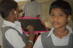 A group of students in Bangladesh are wearing hearing aids.