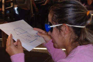A teacher wears a pair of goggles that simulates the vision.