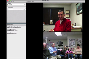 A clip from an online meeting shows video from participants at two locations.