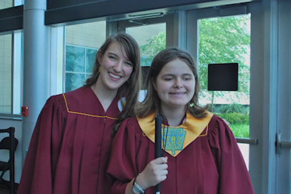 Tim's daughters in  her graduation gown with a stole identifying her as a member of the National Honor Society.