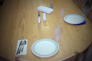 Table set with silverware.