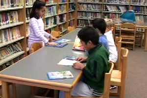 Group of students participating in a library.