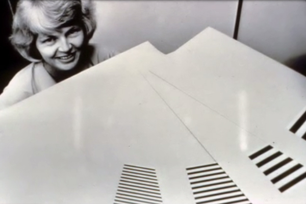 Davida Teller with rectangular cards fanned out in front of her.