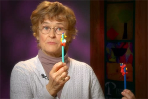 Dr. Mayer describes and demonstrates a vision evaluation using Elmo and Big Bird figurines.
