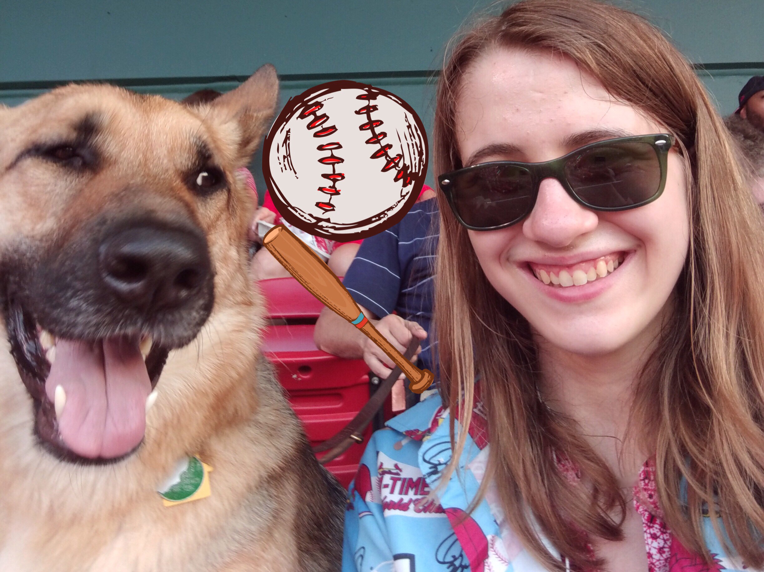 Photo of Veronica and a German Shepherd sitting in the stands with an added cartoon baseball bat and ball.
