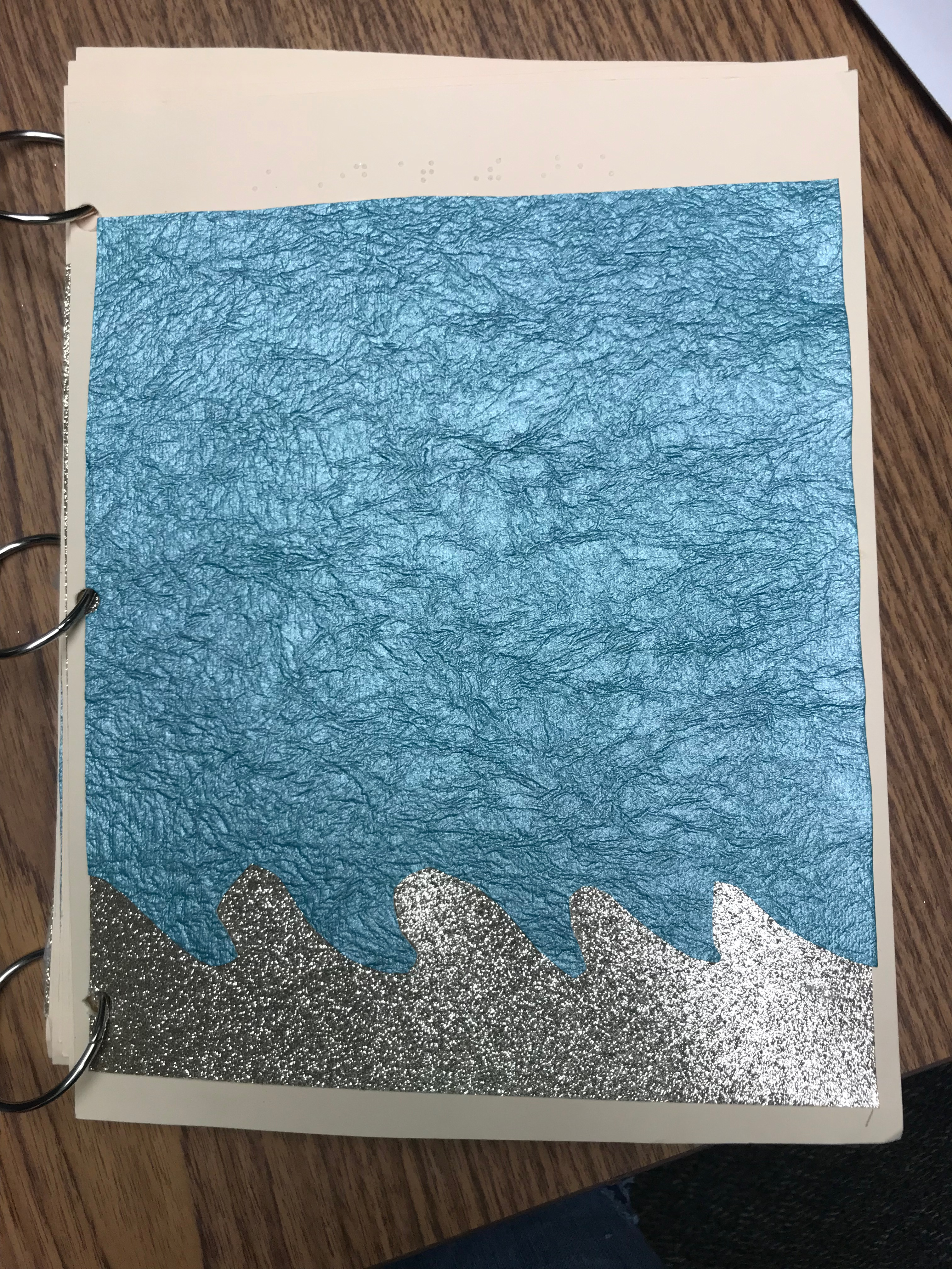 Title Page: Blue wrinkled-textured sky with silver sparkle waves.