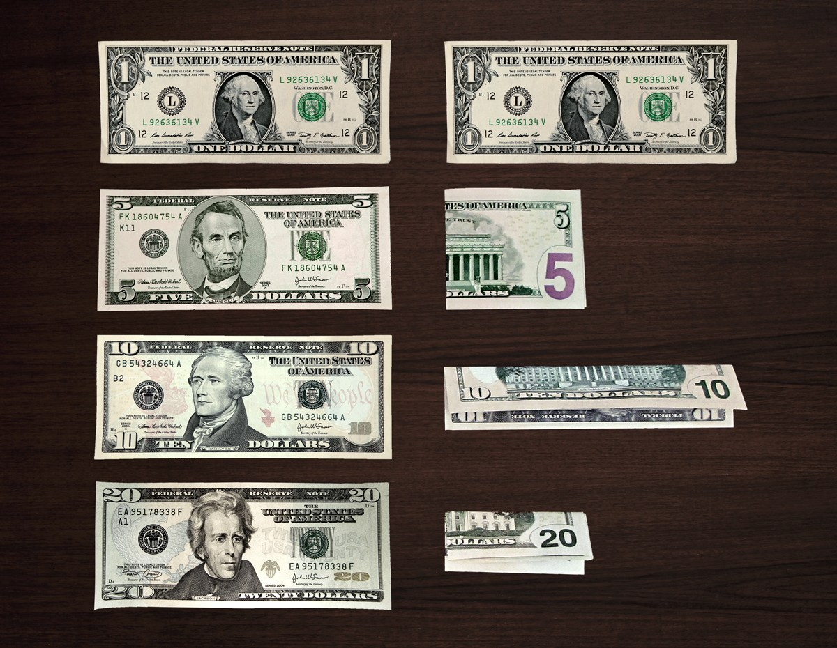 Photo of US bills and their folded equivalent: $1 not folded; $5, folded in half short side; $10 folded long ways, $20 folded both long and short sides.