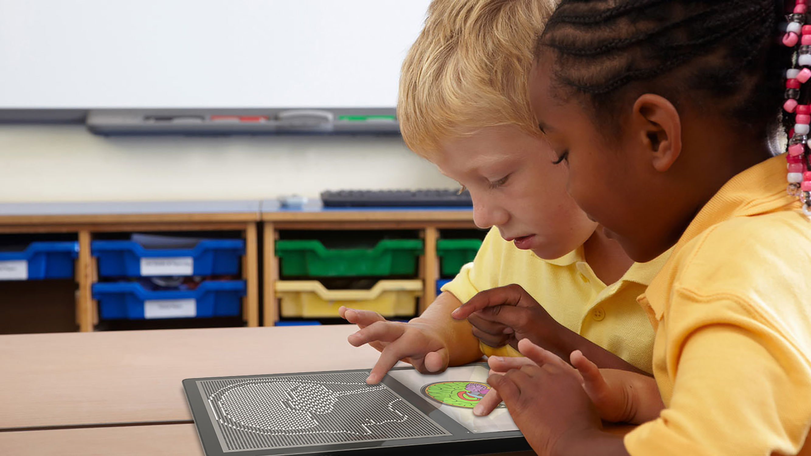 Two young boys exploring the human brain tactually and visually on the Blitab tablet.
