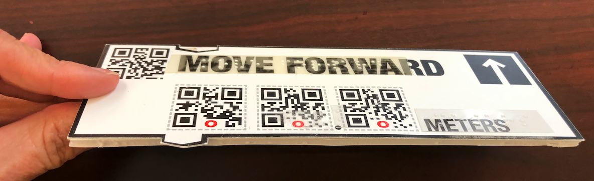 Printed Code block adhered to foam board cut out in rectangular shape; print version has tab sticking out that helps align multiple code blocks together.