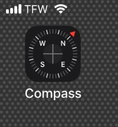 "Compass app showing compass image with North pointing at 2:00 and the word, ""compass""."
