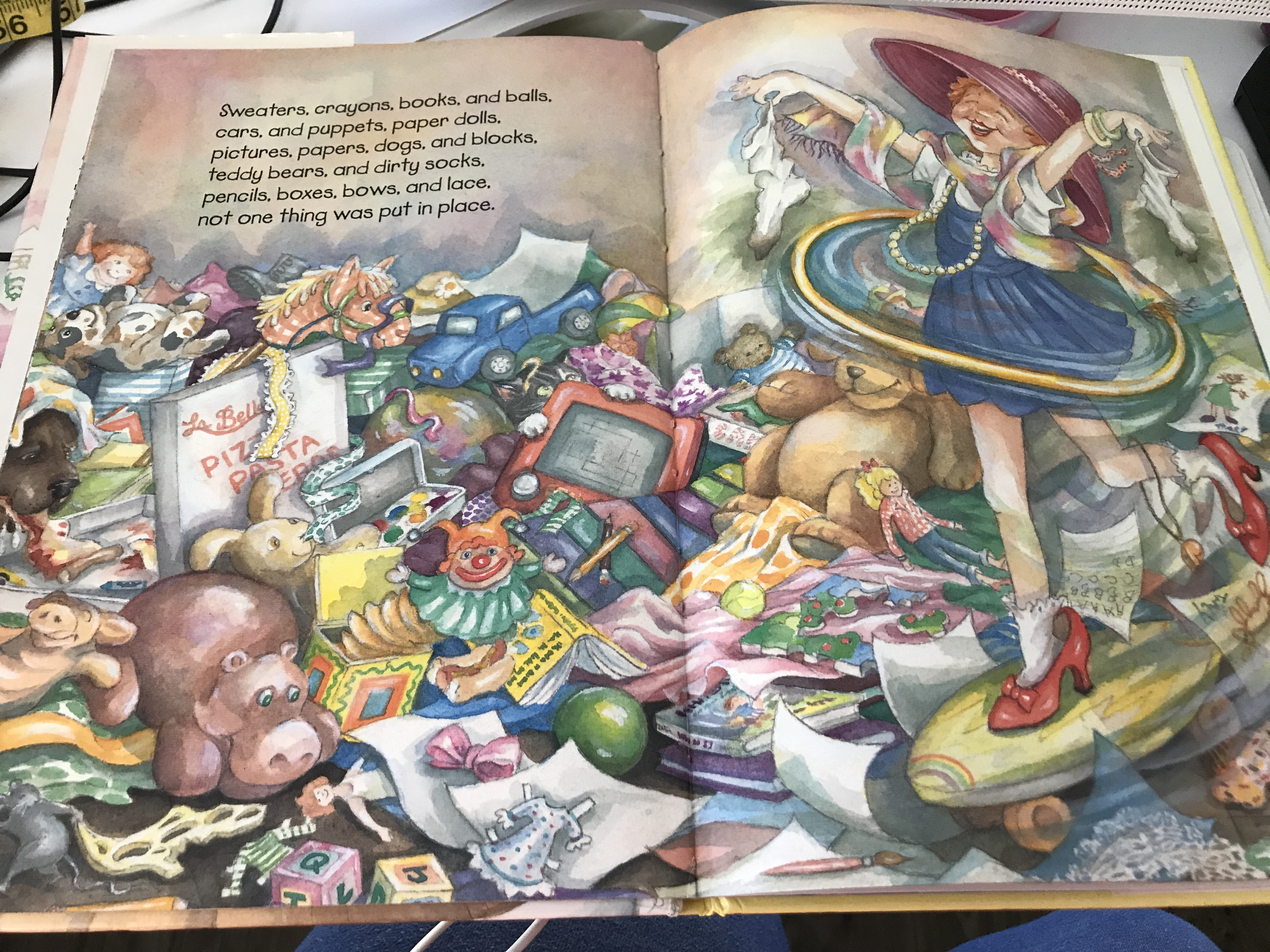 Screenshot of a page in Tracy's Mess book; floor is covered with toys, including a blue pickup truck.
