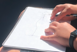 Victor's hands drawing campus roads using the Sensational Blackboard tool