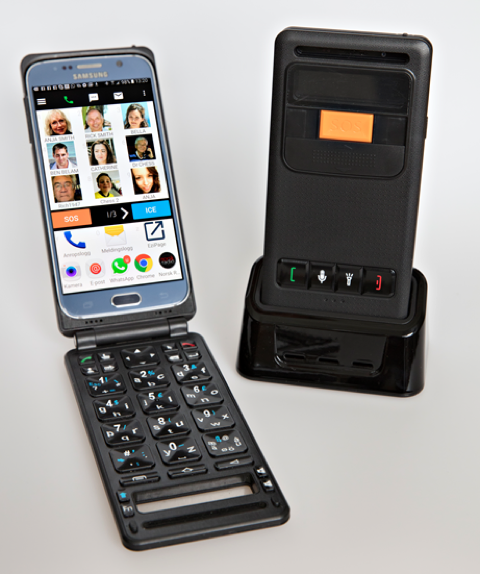 Open Android phone in flip case with special physical keyboard and Android phone in a charging stand.