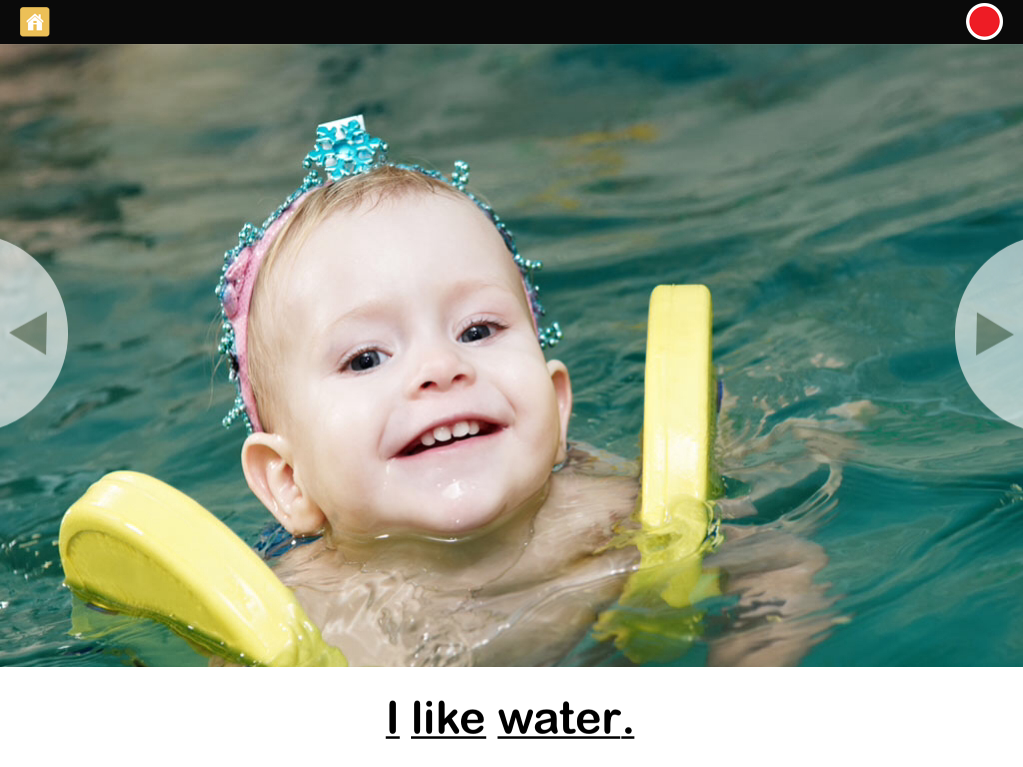 Screenshot of I Like Water book: smiling toddler in pool with arm bands keeping her chin just above the water.