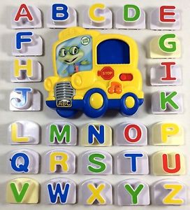 Photo of LeapFrog Fridge Phonics game: yellow cartoon bus base with individual colorful alphabet pieces that insert into the window on the base.
