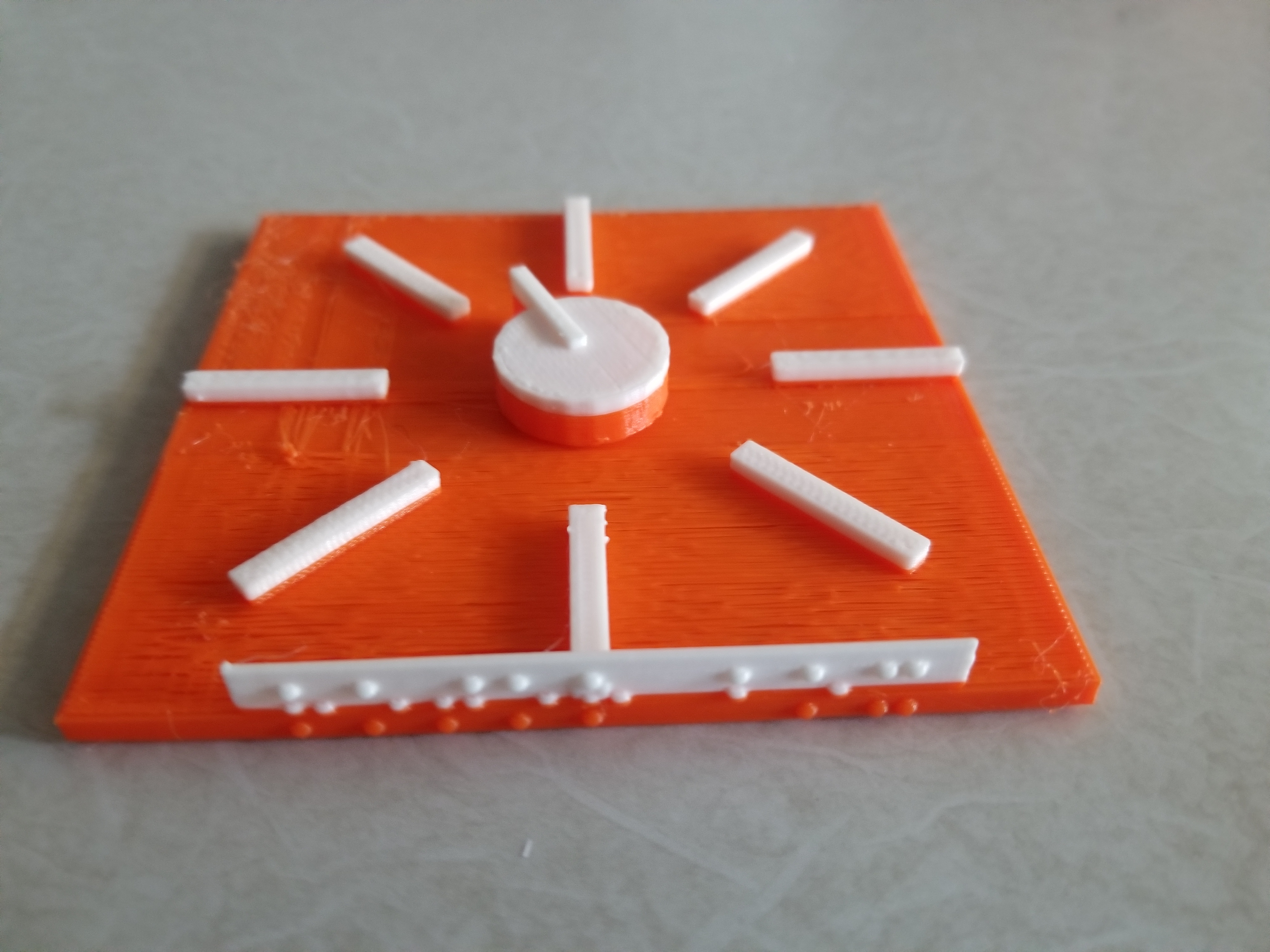 Photo: top view of 3D printed rotor box with orange base and white spinnable dial