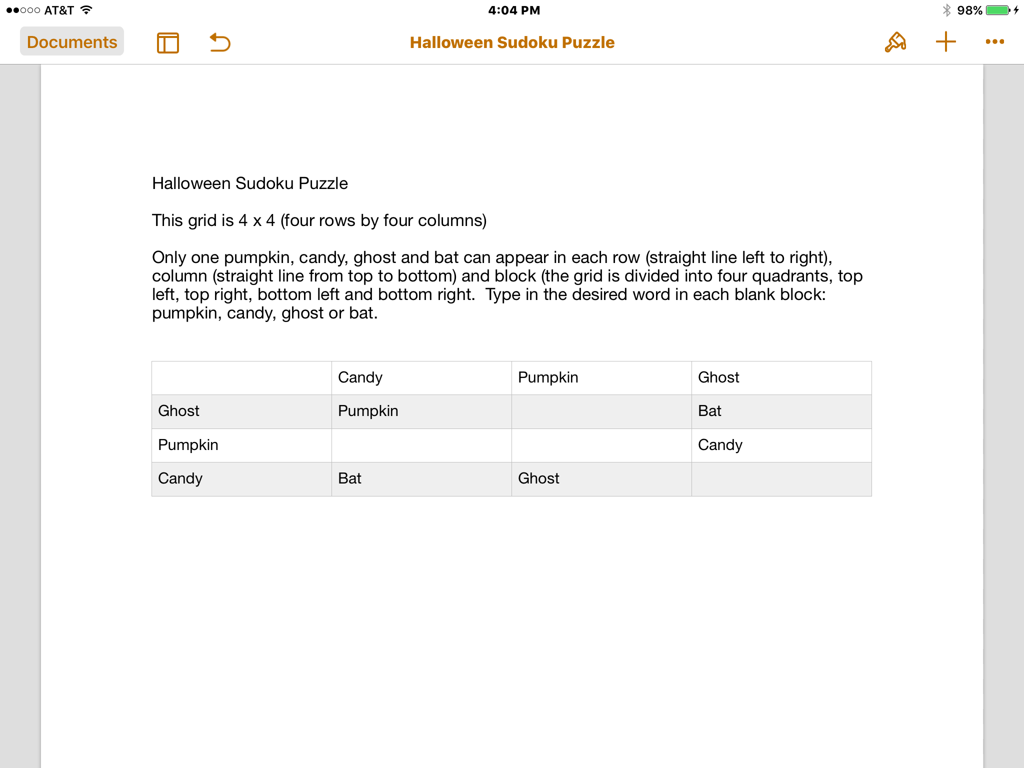 Accessible Halloween Sudoku puzzle - a table created in pages with the words, ghost, pumpkin, candy and bat.