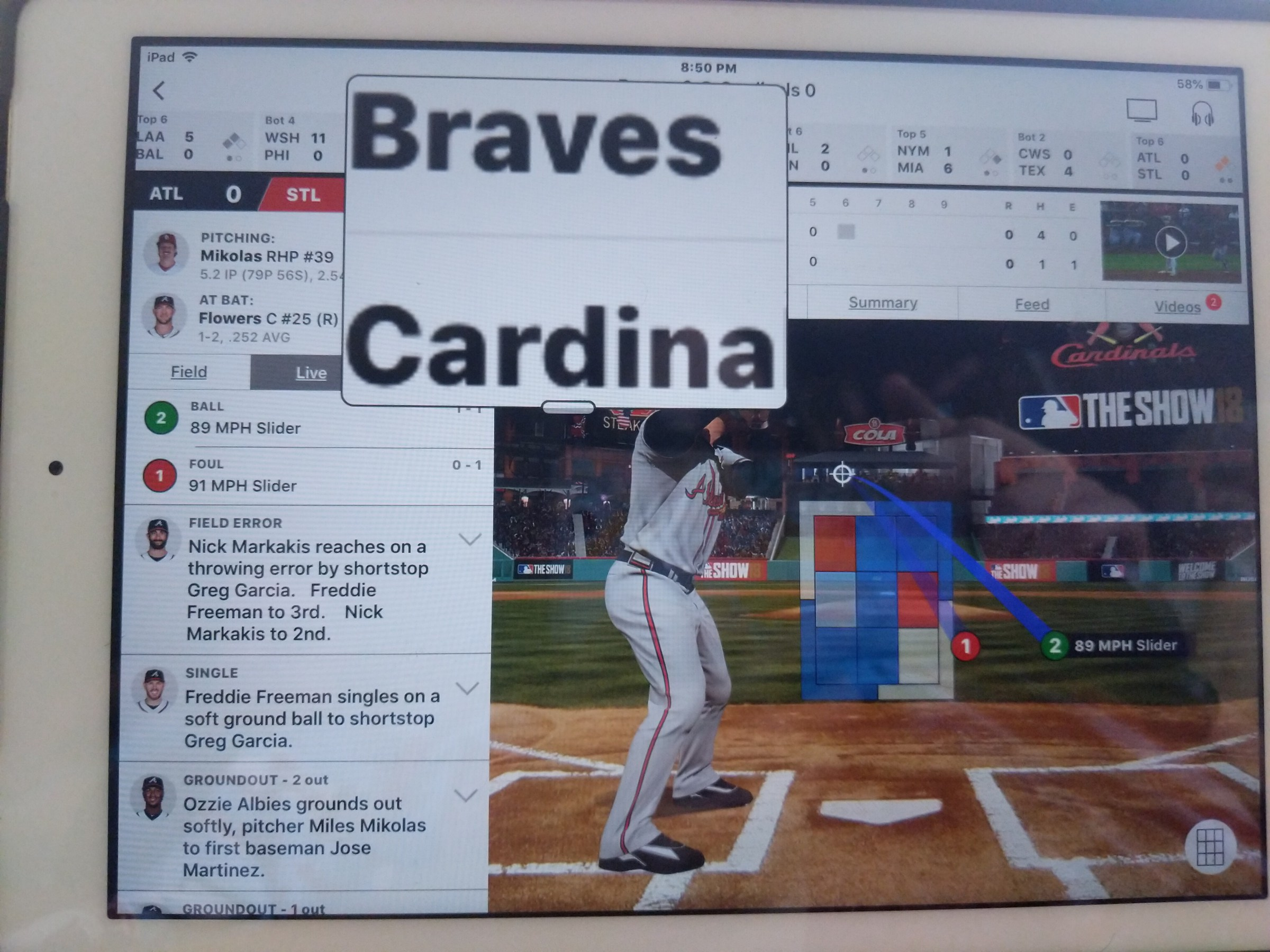 "Photo of an iPad with ATBAT app displaying batter, stats and Zoom Window showing text ""Braves Cardinals"""