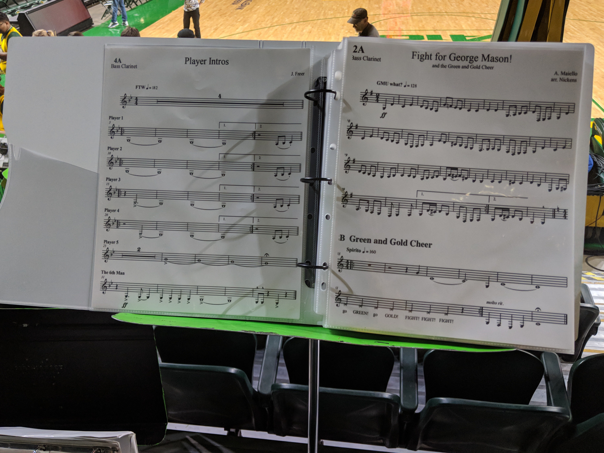 A binder with sheet music resting on a stand.