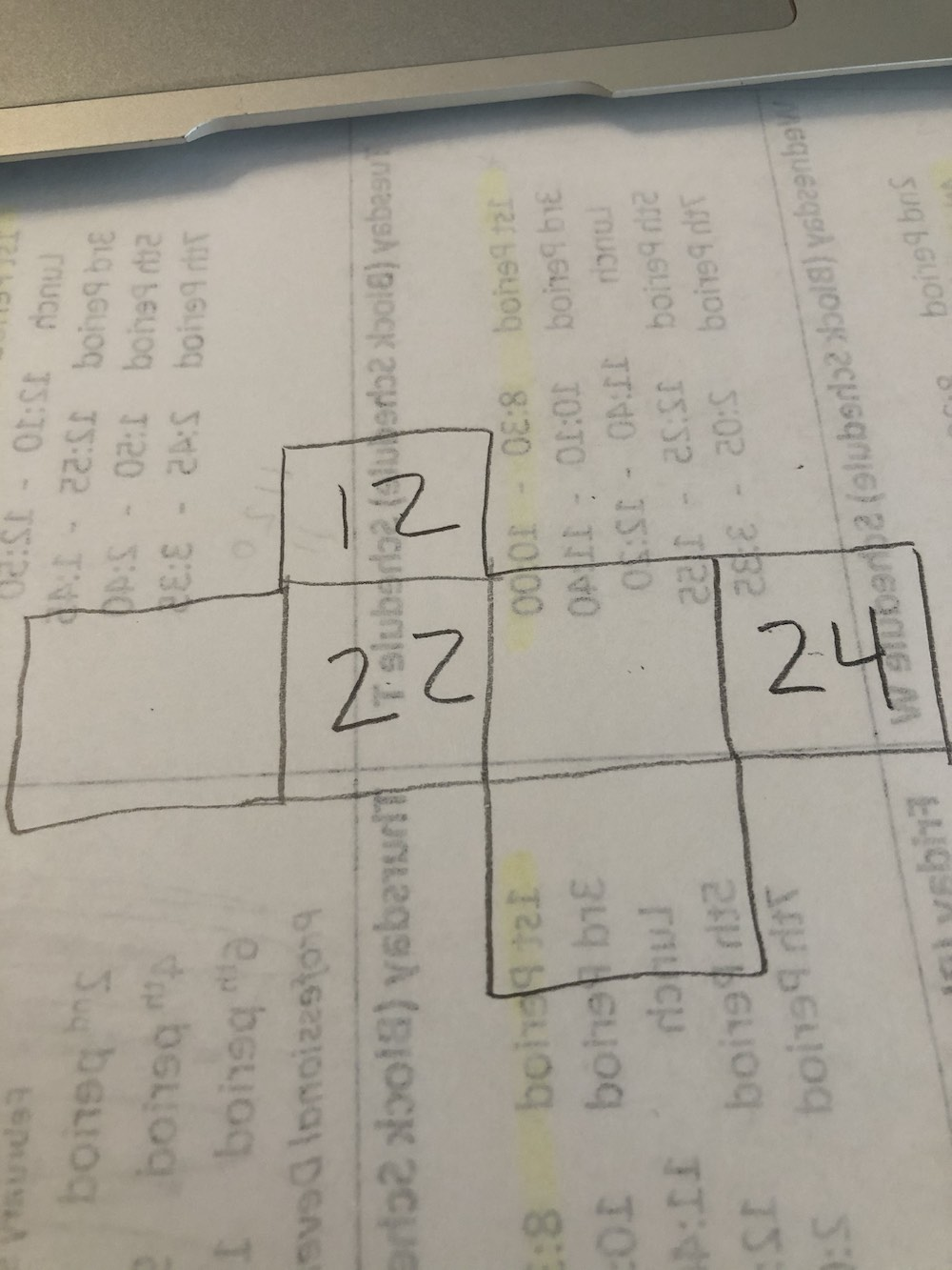 A pencil drawing of a partial 3x4 grid with the numbers 12, 22 and 24 filled in and three blank squares.